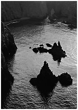 Rocks and ocean, Cathedral Cove, Anacapa, late afternoon. Channel Islands National Park, California, USA. (black and white)