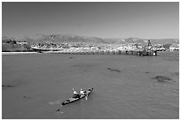 Kayakers in Bechers Bay, Santa Rosa Island. Channel Islands National Park, California, USA. (black and white)