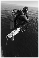 Scuba diver jumping from boat. Channel Islands National Park, California, USA. (black and white)