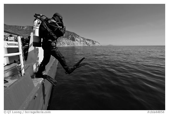 Scuba diver stepping out of boat, Santa Cruz Island. Channel Islands National Park (black and white)