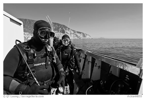 Scuba divers in wetsuits ready to dive from boat, Santa Cruz Island. Channel Islands National Park (black and white)