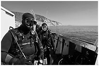 Scuba divers in wetsuits ready to dive from boat, Santa Cruz Island. Channel Islands National Park, California, USA. (black and white)
