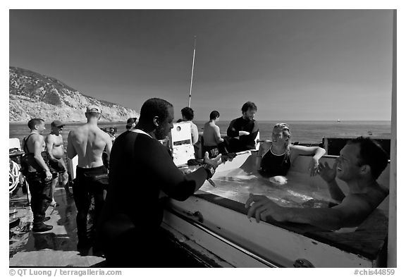 Divers in hot tub aboard the Spectre dive boat, Santa Cruz Island. Channel Islands National Park (black and white)