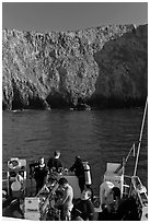 Dive boat and cliffs, Annacapa Island. Channel Islands National Park, California, USA. (black and white)