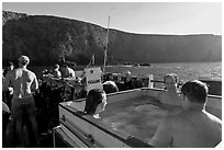 Divers relaxing in hot tub aboard the Spectre and Annacapa Island. Channel Islands National Park, California, USA. (black and white)