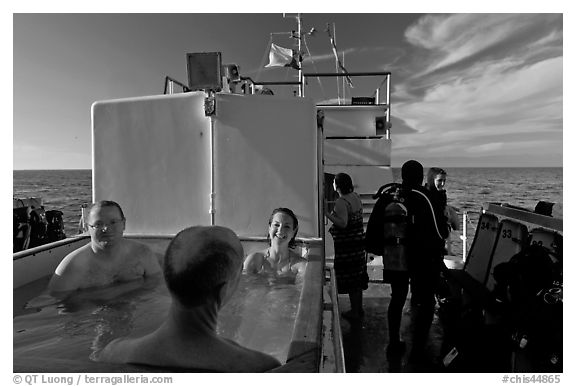 Soaking in hot tub on diving boat, Annacapa Island. Channel Islands National Park (black and white)