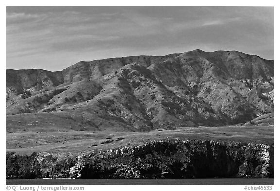 Tall hill ridge and cliff seen from ocean, Santa Cruz Island. Channel Islands National Park (black and white)