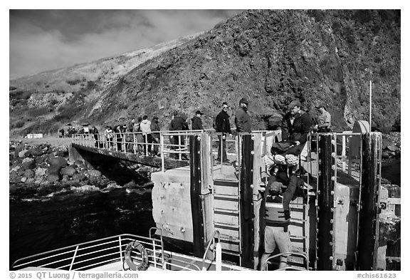Unloading via human chain, Scorpion Anchorage, Santa Cruz Island. Channel Islands National Park (black and white)