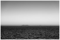 Sunrise over Catalina Island from Santa Barbara Island. Channel Islands National Park ( black and white)
