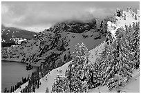 Trees and cliffs in winter. Crater Lake National Park, Oregon, USA. (black and white)