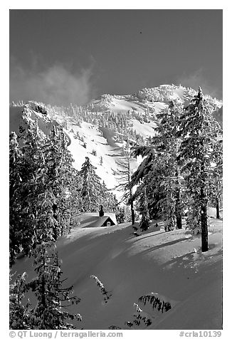 Cabin in winter with trees and mountain. Crater Lake National Park (black and white)