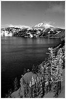 Lake rim in winter with blue skies. Crater Lake National Park, Oregon, USA. (black and white)