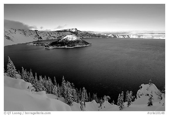 Wizard Island and lake in late afternoon shade, winter. Crater Lake National Park (black and white)