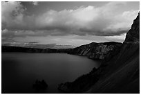Phantom ship and lake seen from Sun Notch, sunset. Crater Lake National Park ( black and white)