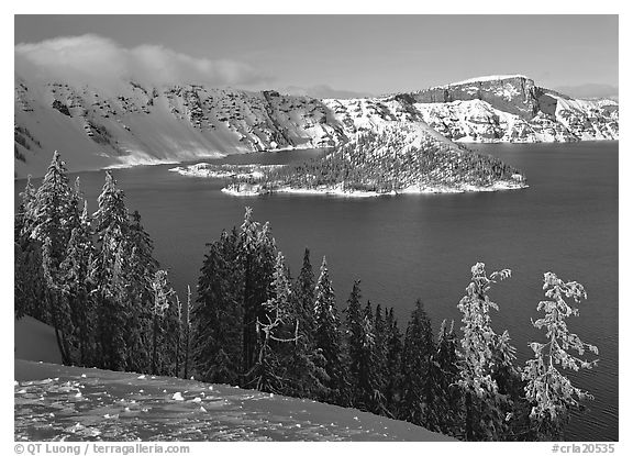 Lake and Wizard Island in winter, sunny afternoon. Crater Lake National Park (black and white)
