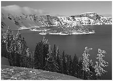 Lake and Wizard Island in winter, sunny afternoon. Crater Lake National Park, Oregon, USA. (black and white)
