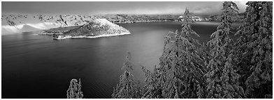 Light on the lake, winter sunrise. Crater Lake National Park (Panoramic black and white)