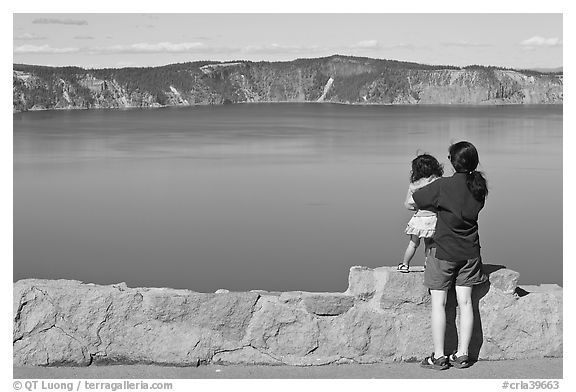 Woman and baby looking at Crater Lake. Crater Lake National Park (black and white)