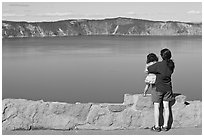 Woman and baby looking at Crater Lake. Crater Lake National Park, Oregon, USA. (black and white)