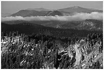 Lake rim and forest, and hills. Crater Lake National Park, Oregon, USA. (black and white)