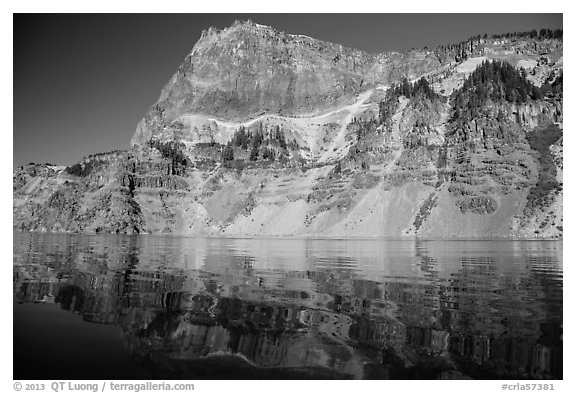 Llao Rock reflected in rippled water. Crater Lake National Park (black and white)