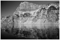 Llao Rock reflected in rippled water. Crater Lake National Park ( black and white)