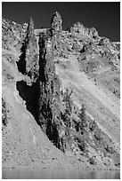 Devils Backbone, vertical dike of dark andesite lining the cliff face. Crater Lake National Park ( black and white)