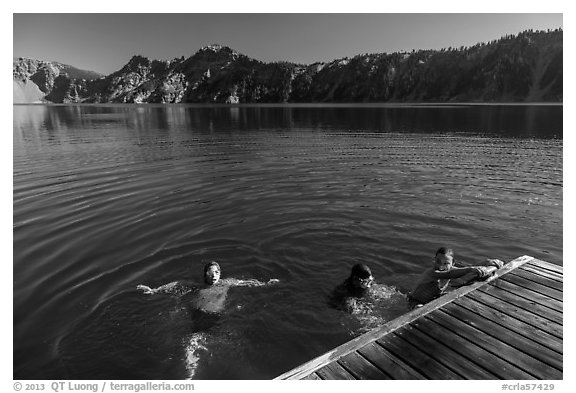 Girls swim from Wizard Island dock. Crater Lake National Park (black and white)