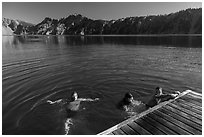 Girls swim from Wizard Island dock. Crater Lake National Park ( black and white)