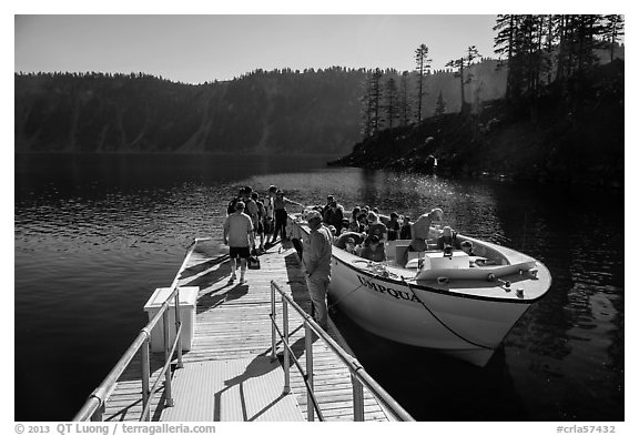 Visitors embark on tour boat at Wizard Island boat dock. Crater Lake National Park (black and white)