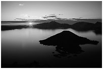 Sun rising below cloud band. Crater Lake National Park ( black and white)