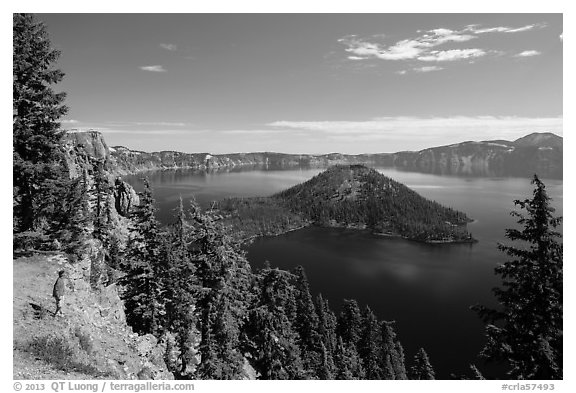 Visitor looking, Wizard Island and lake. Crater Lake National Park (black and white)