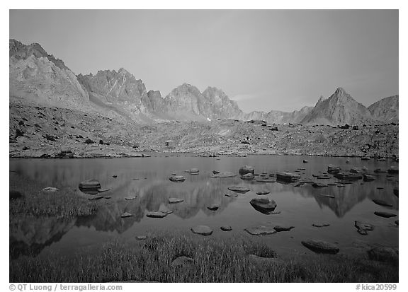 Mt Agasiz, Mt Thunderbolt, and Isoceles Peak reflected in a lake in Dusy Basin, sunset. Kings Canyon National Park (black and white)