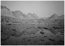 Mt Agasiz, Mt Thunderbolt, and Isoceles Peak reflected in a lake in Dusy Basin, sunset. Kings Canyon  National Park ( black and white)