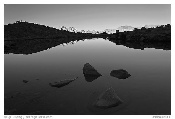 Rocks and calm lake with reflections, early morning, Dusy Basin. Kings Canyon National Park (black and white)