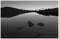 Rocks and calm lake with reflections, early morning, Dusy Basin. Kings Canyon National Park, California, USA. (black and white)