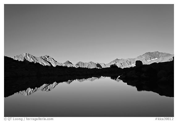 Mountain range reflected in calm lake, Dusy Basin. Kings Canyon National Park (black and white)