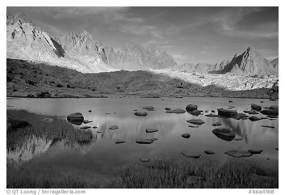 Mt Agasiz, Mt Thunderbolt, and Isoceles Peak reflected in a lake in Dusy Basin, late afternoon. Kings Canyon National Park, California, USA.
