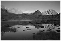 Mt Thunderbolt, Isoceles Peak, and Palissades reflected in a lake in Dusy Basin, sunset. Kings Canyon National Park, California, USA. (black and white)