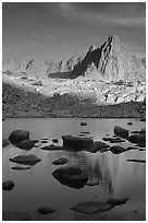 Isoceles Peak reflected in a lake in Dusy Basin, late afternoon. Kings Canyon National Park, California, USA. (black and white)
