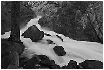 Forceful waterfall rushing through narrow granite chute. Kings Canyon National Park, California, USA. (black and white)