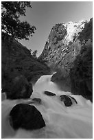 Roaring River Falls below high granite cliff. Kings Canyon National Park, California, USA. (black and white)