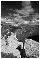 Hiker taking in view from Lookout Peak. Kings Canyon National Park, California, USA. (black and white)