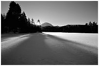 Frozen Manzanita Lake, winter sunrise. Lassen Volcanic National Park, California, USA. (black and white)
