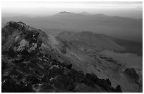 Summit of Lassen Peak with volcanic formations, sunset. Lassen Volcanic National Park, California, USA. (black and white)