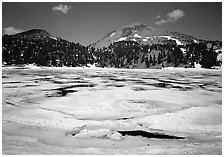 Helen Lake with Ice breaking up, and Lassen Peak. Lassen Volcanic National Park, California, USA. (black and white)