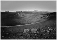 Sagebrush bushes, Cinder cone rim, and Lassen Peak, sunrise. Lassen Volcanic National Park, California, USA. (black and white)