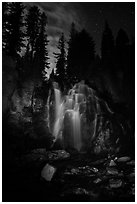 Dimly lit Kings Creek Falls and sky at night. Lassen Volcanic National Park ( black and white)