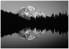 Mount Rainier with calm reflection in Eunice Lake, sunset. Mount Rainier National Park, Washington, USA. (black and white)