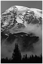 Mount Rainier rising above fog at sunrise. Mount Rainier National Park, Washington, USA. (black and white)